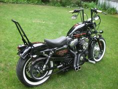 Harley-Davidson custom Sportster with angled mini apes, sissy bar and chopped pipes