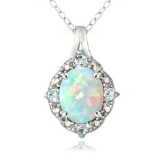 This lovely necklace features an oval-cut opal set in the center with four blue topaz gemstones and a genuine diamond adorning the intricately designed border. This necklace is crafted of fine sterling silver and shines with a high polish finish.