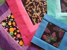 "Cynthia from ""Quilting is more fun than Housework"" found a great way to use up a lot of leftover bits of ""brights on black"" fabric. More pics, including the full quilt, at the source."