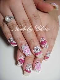 Layered roses, shiny crystals, hearts with frilly trimmings.  petitnaildiary.blogspot.com