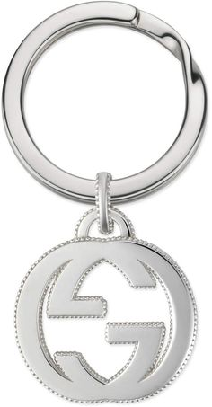 8f8b4a49a08 Shop the Interlocking G keychain in silver by Gucci. A keychain in sterling  silver featuring the interlocking G motif with a textured edge.