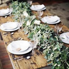Floating candles and lush greenery runners with babies breath pair ...