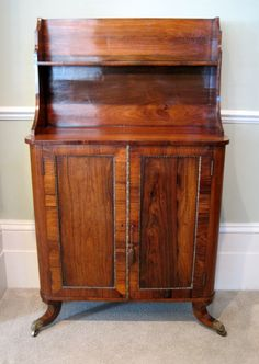 1820 ca. Side Cabinet or Chiffonier. Regency, rosewood inlaid with brass stringing, raised on sabre legs and brass castors.  wilkinsonantiques.co.uk     suzilove.com