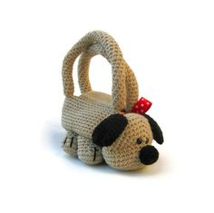 Crochet animal bag dog purse novelty stuffed animal purse cute children kids handbag Roger the dog.Loyally fierce and fiercely loyal, this adorable fella is guaranteed to never give you up or let you down. With a heart even bigger than his rough black nose, he will carry your things and protect you to the ends of the earth. Enjoys walks, apple juice and sunbathing.Roger  Read More the Dog measures w29 cm/11.5inch x h30 cm/12inch to the top of the handles, his little buttoned fasteni...