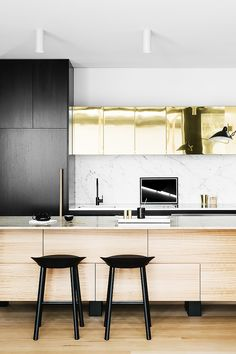 Australian kitchen. Not sure what's going on with those ceiling lights, and the brass might be too flashy for me, but is that I Mouille I spy?
