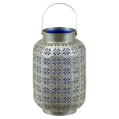 Metal lantern with openwork exterior and blue interior.   Product: LanternConstruction Material: Metal and glass
