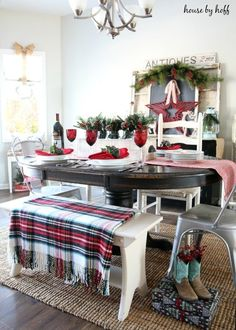 A giant red star watches over a vibrant dining table in blogger April's Christmas home.  See the full tour at House by Hoff.    - CountryLiving.com