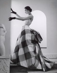 "Model with sculpture (1952). Photograph by André Ostier-Heil. Model is wearing a silk dress by Pierre Balmain for the summer 1952 collection. Known for sophistication and elegance, Balmain described the art of dressmaking as ""the architecture of..."