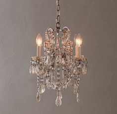 RH TEEN's Manor Court Crystal 4-Arm Chandelier - Antiqued Silver:Inspired by an antique find, our collection's scrolling arms are draped with strands of glass beads and faceted cystals in a mix of shapes and sizes. Manor's ornate silhouette and burnished metal finish impart an elegant, aged aesthetic.