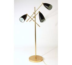 Floor lamp - Trilight    Metal frame  Adjustable powder coated shades     Use maximum 60 watt light bulb  Organic Modernism
