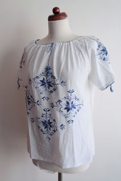 https://www.etsy.com/listing/225962395/vintage-peasant-blouse-1970s-floral?ref=shop_home_active_4