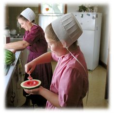 Amish mother and daughter in the kitchen