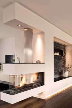 Who needs a living room wall when he has such a beautiful panoramic gas fireplace with modern stone paneling and white plaster. Who needs a living room wall when he has such a beautiful panoramic gas fireplace with modern stone paneling and white plaster. Home Fireplace, Modern Fireplace, Fireplace Design, Double Fireplace, Ethanol Fireplace, Fireplace Ideas, Fireplaces, Elegant Home Decor, Elegant Homes