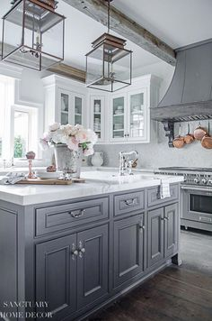 How to Decorate with Faux Flowers and Greenery-White Kitchen-White cabinets with glass-Marble countertops-Rustic wood beams-Pendant light fixtures-Double Center Island-Restoration Hardware Paint-Flint Glass Kitchen Cabinet Doors, White Kitchen Cabinets, Kitchen Countertops, Kitchen White, Marble Countertops, White Kitchens, Gray Cabinets, Soapstone Kitchen, Antique Cabinets
