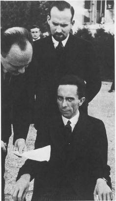 Nazi propaganda minister Joseph Goebbels glaring at a Jewish photographer at a League of Nations meeting, 1933 x Emo, Colorized History, Joseph Goebbels, Nazi Propaganda, Video Caption, Empire, Nikola Tesla, Historical Images, Charlie Chaplin