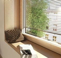 Relax in this window seat next to Internorm's I-tec shading windows, with integrated blinds for sun protection. #windowseat #room #fenster