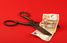 Budget cut, EUR crisis illustration, 50 EUR banknote and old vintage scissors 50 Euro Banknote Budget Close-up Colored Background Crisis Cute Devaluation Economy Euro Europe Exchange Finance Inflation  Money Paper Currency Problem Rate Recession Red Red Background Reduction Saving Scissors Studio Shot
