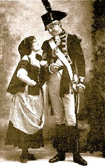 """Agnes Fraser as Kathleen and Richard Crompton as Sergeant Pincher in the original 1901 production of """"The Emerald Isle"""" at the Savoy Theatre."""