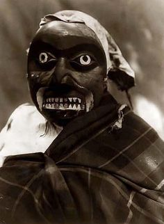 Mask of the Octopus Hunter, taken in 1914 by Edward S. Curtis. The image shows a Ceremonial mask worn by a dancer portraying the hunter in Bella Bella mythology who killed the giant man-eating octopus. The dance was performed during Tluwulahu, a four day ceremony prior to the Winter Dance.