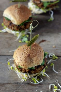 Walnut lentil burger with mushrooms and sesame seeds topped with avocado