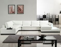 astonishing-u-shaped-white-leather-sectional-sofa-with-black-polished-hardwood-base-on-glazed-ceramic-floors-and-small-grey-rugs-as-well-as-rectangle-glass-coffee-table-be-equipped-double-lower-shelf-1120x872.jpg (1120×872)
