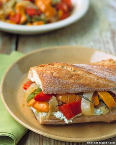 Peperonata Sandwiches __   Red, green, and yellow bell peppers, sauteed with onion and seasonings, are cooled and served with goat-cheese spread on crusty baguettes.