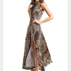 Joseph Ribkoff Original Description: Joseph Ribkoff black and brown beautiful cheetah maxi dress. Side open slit, flowy bottom.  Back zipper closure. Unlined.   Color: Black/Brown  Material: 92% Polyester, 8% Spandex  Originally $285 Joseph Ribkoff Dresses Maxi