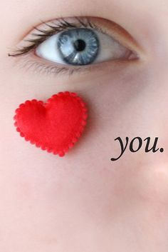 I love you written by placing a heart on the girls face by her eye, and then typing the word you.