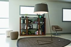 Floor lamp with a minimalist look that is ideal for contemporary interiors: whether living rooms, work tables or studies. Sextans features a large fabric shade (diameter: 28 inches) in a colour matching the coated metal stand and wide base.