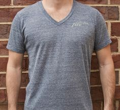 Guys V-Neck Eco Navy - Cultivation Five is a T-shirt line that joins style, comfort and class with giving back to the community.  Partnering with children's charities, the company donates $5 to the charity chosen by you, the consumer, with each T-shirt sold.  With your purchase, you will also be provided with a handmade drawstring bag. #C5 #CharityFashion #GiveBack