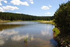 """Roubaix Lake (pronounced """"row bay"""" is at elevation 5,500ft) is another great Black Hills Lake.  It is located about 20 minutes south of Deadwood on Hwy 385.    It has a nice sandy beach and some day use picnic areas.  It also has loads of camping spots for tents or RVs.    Services. There is fresh water for drinking, but the only facilities are vault toilets.  Check out Executive Lodging of the Black Hills for all your lodging needs."""