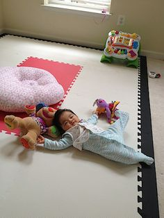 """I got her soft tiles to form this gigantic play mat"". These are SoftTiles 2x2 Foam Mats with sloped borders."