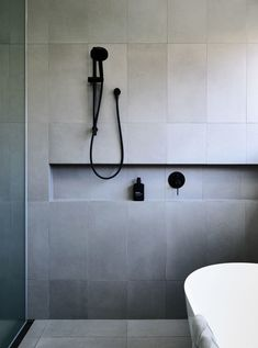 Simple and elegant bathroom with black tapware, large format grey tiles and free standing bath, recessed shower shelf Bathroom Renos, Laundry In Bathroom, Grey Bathrooms, Bathroom Renovations, Bathroom Wall, Modern Bathroom, Small Bathroom, Luxury Bathrooms, Bathroom Faucets