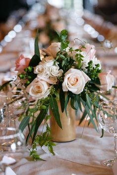Sprawling rose #centerpiece in a modern gold vase.  Photography: Averyhouse - averyhouse.net  Read More: http://www.stylemepretty.com/2014/08/15/classic-meets-modern-indiana-wedding/