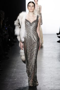 Dennis Basso crystal encrusted gown with sheer side panels paired with a white fur stole - Fall 2016 Ready-to-Wear Fashion Show #NYFW...x