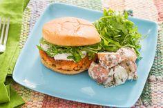 Salmon Burgers with Crème Fraîche Sauce & Potato Salad . Visit https://www.blueapron.com/ to receive the ingredients.