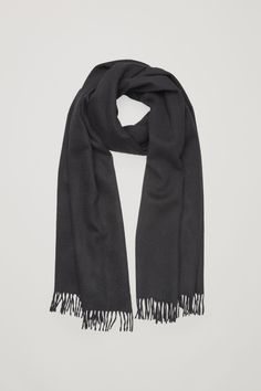 This scarf is made from a wool blend with a touch of soft cashmere and thick fringing at the edges.