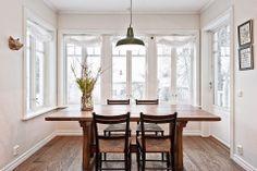 Bright light in dining room. Beautiful wood floors.