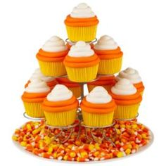 Bet these are better than the candy! Delight your guests with cupcakes ringed in orange and white buttercream icing. They're easy to create using our tip 2A.