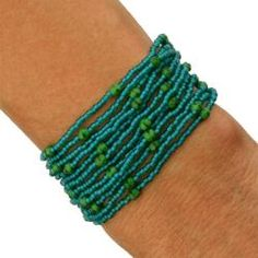 This playful handcrafted bracelet drapes the wrist gracefully and accents the most casual of outfits. The Misha 'Caribbean' bracelet is hand-woven by indigenous Mayan women in Lake Atitlan, Guatemala with glass seed beads and Czech crystals.