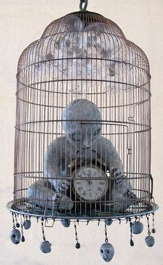 I think an old alarm clock with wings in a bird cage would look pretty cool.