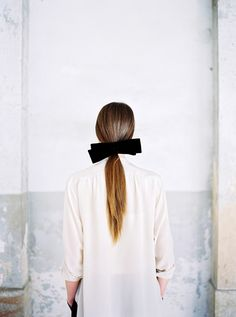 white shirt, black bow