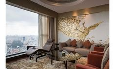Luxury amenities and fine furnishings by the likes of Frank Lloyd Wright and Baldi make The Reverie Saigon the jewel of Ho Chi Minh City, Vietnam. Pictured here is the living room in a two-story Designer Suite by Giorgetti.