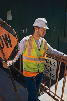 Hardhat and Clothing Help- Meets Conformity because it keeps him safe and easy to notice on the job