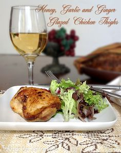 Honey, Garlic and Ginger Glazed Chicken Thighs | Taking On Magazines | www.takingonmagazines.com | A little sweet, a little heat, a whole lot of sassy, and finger lickingly delicious. #weightlossrecipes