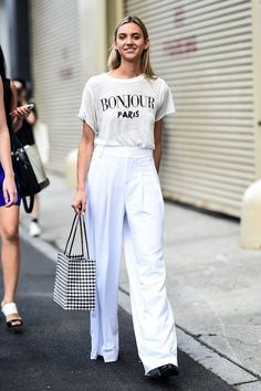 Make like this street style star and pair your favorite white graphic tee with…