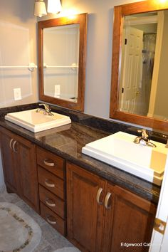 Bathroom vanity in second bath with matching mirror frames
