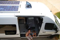 "Our Sprinter campervan conversion uses diesel and solar power only - a 200W solar system, a diesel cooktop/heater, and a super-efficient 12V DC fridge. Plus we cram sleeping for 4 into a 144"" Sprinter camper!"