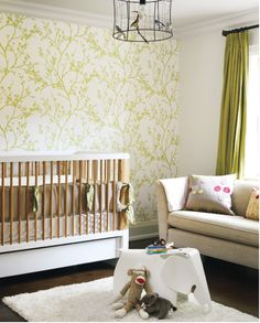 love the green accent wall and the idea of a small sofa in the nursery- how comfie is that?!