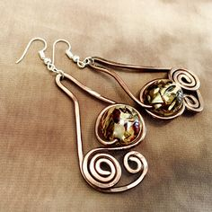 Amazing handmade wire earrings with glass by #pictordesign  Find your favorite pair at our online shop: link in bio.  #handmade #jewelry #wiredesign #wireearrings #wirejewelry #wire #glass #brown #jewelrydesign #handmadejewelry #unique #handpainted #silk #handcrafted #art #craft #fashion #style #design #ljubljana #madeinslovenia #pictorshop